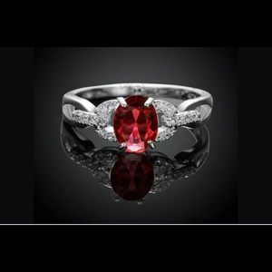 Jewelry - 925 silver Red Ruby center 2 AAA zirconia sides